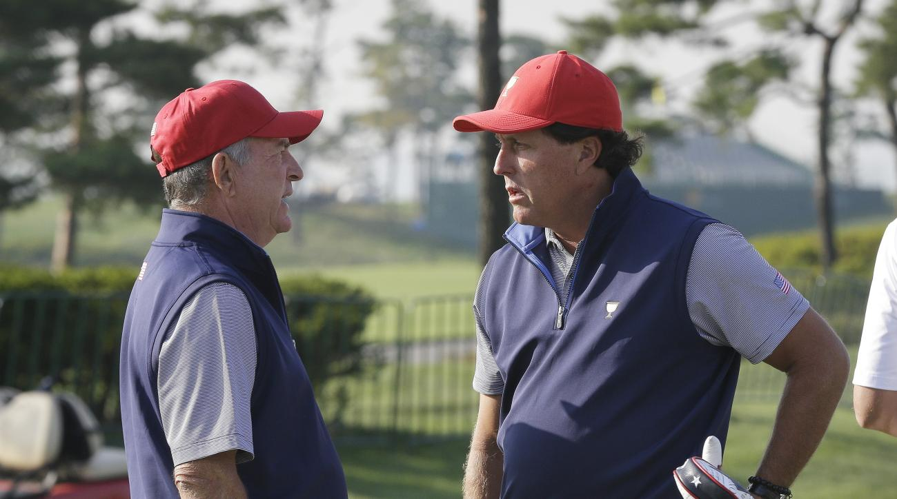 United States team captain Jay Haas, left, talks with his team player Phil Mickelson during a practice round ahead of the Presidents Cup golf tournament at Jack Nicklaus Golf Club Korea in Incheon, South Korea, Tuesday, Oct. 6, 2015. (AP Photo/Ahn Young-j