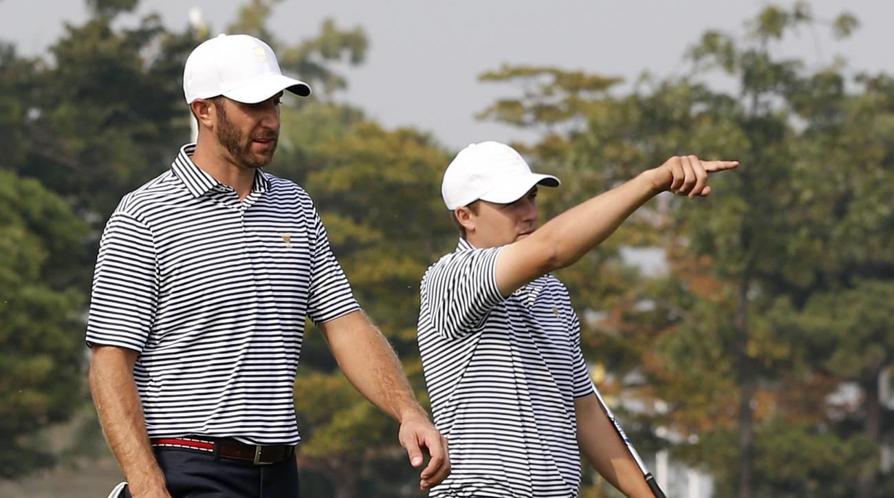 United States' Jordan Spieth, right, gestures as he walks a fairway with teammate Dustin Johnson during their final practice round ahead of the Presidents Cup golf tournament at the Jack Nicklaus Golf Club Korea, in Incheon, South Korea, Wednesday, Oct. 7