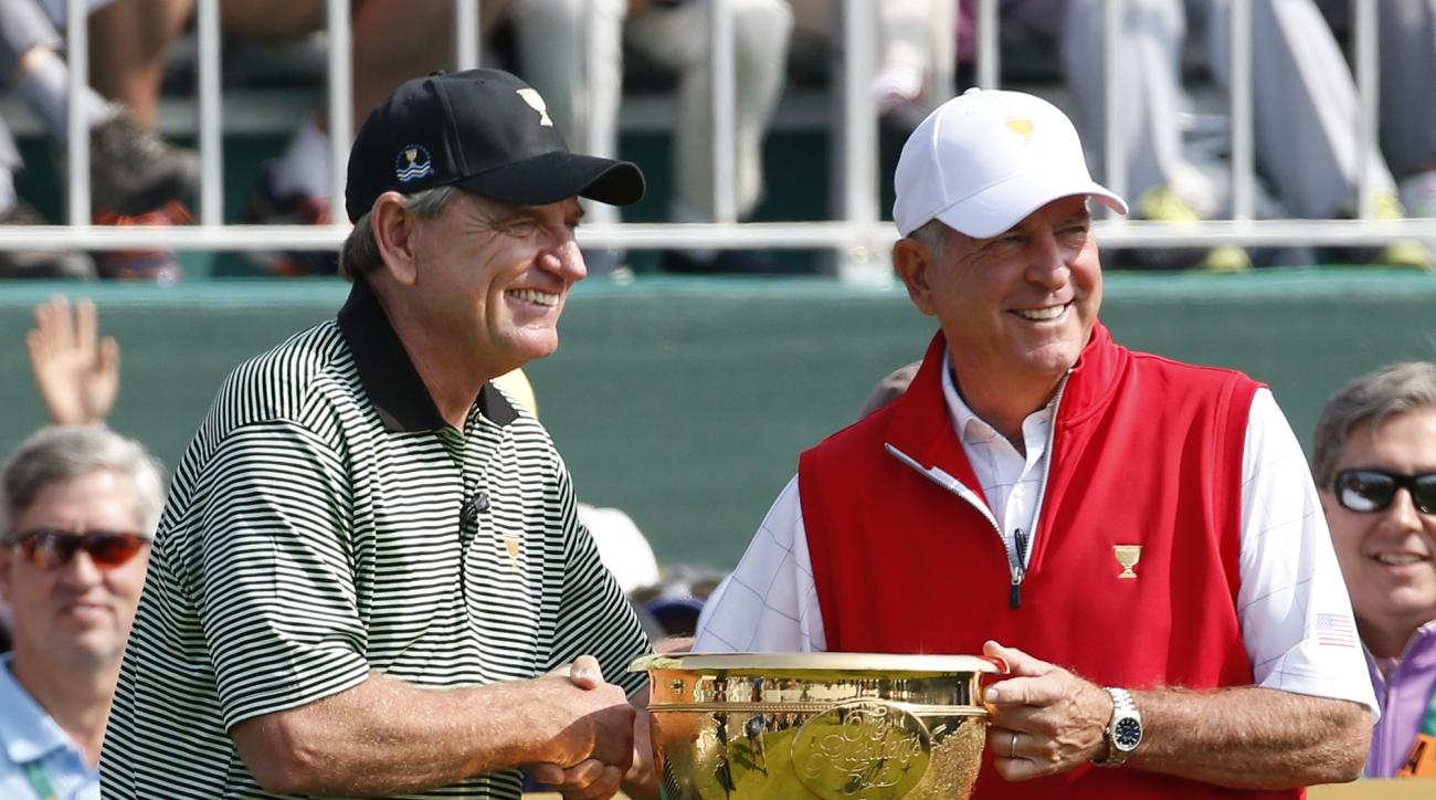 International team captain Nick Price, left, shakes hands with his rival captain Jay Haas, of the US  prior to the start of the first day's play of the Presidents Cup golf tournament at the Jack Nicklaus Golf Club Korea, in Incheon, South Korea, Thursday,