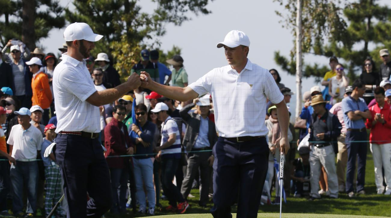 United States' Dustin Johnson, left, and teammate Jordan Spieth celebrate during their foursome match at the Presidents Cup golf tournament at the Jack Nicklaus Golf Club Korea, in Incheon, South Korea, Thursday, Oct. 8, 2015.(AP Photo/Lee Jin-man)