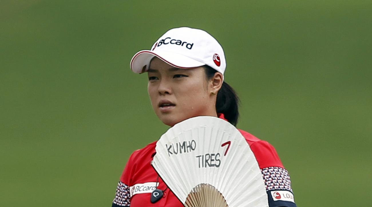 Ha Na Jang of South Korea fans herself on the eighteenth hole during the second round of the LPGA Malaysia golf tournament at Kuala Lumpur Golf and Country Club in Kuala Lumpur, Malaysia, Friday, Oct. 9, 2015.(AP Photo/Joshua Paul)