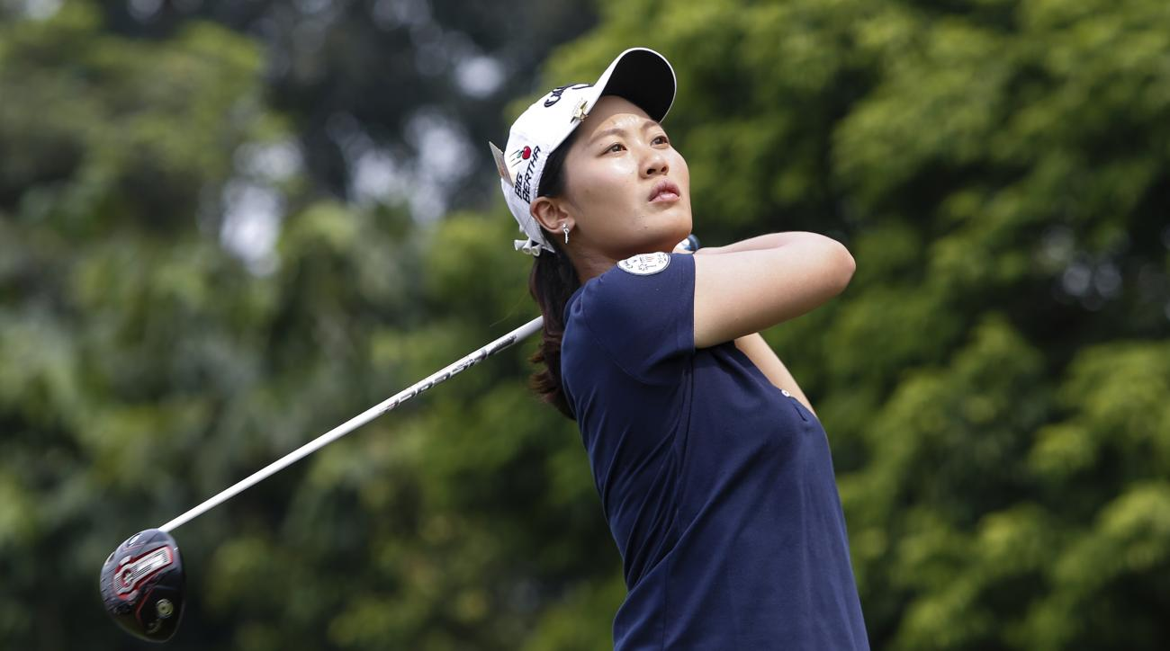 Xi Yu Lin of China watches her shot on the sixth hole during the third round of the LPGA Malaysia golf tournament at Kuala Lumpur Golf and Country Club in Kuala Lumpur, Malaysia, Saturday, Oct. 10, 2015. (AP Photo/Joshua Paul)