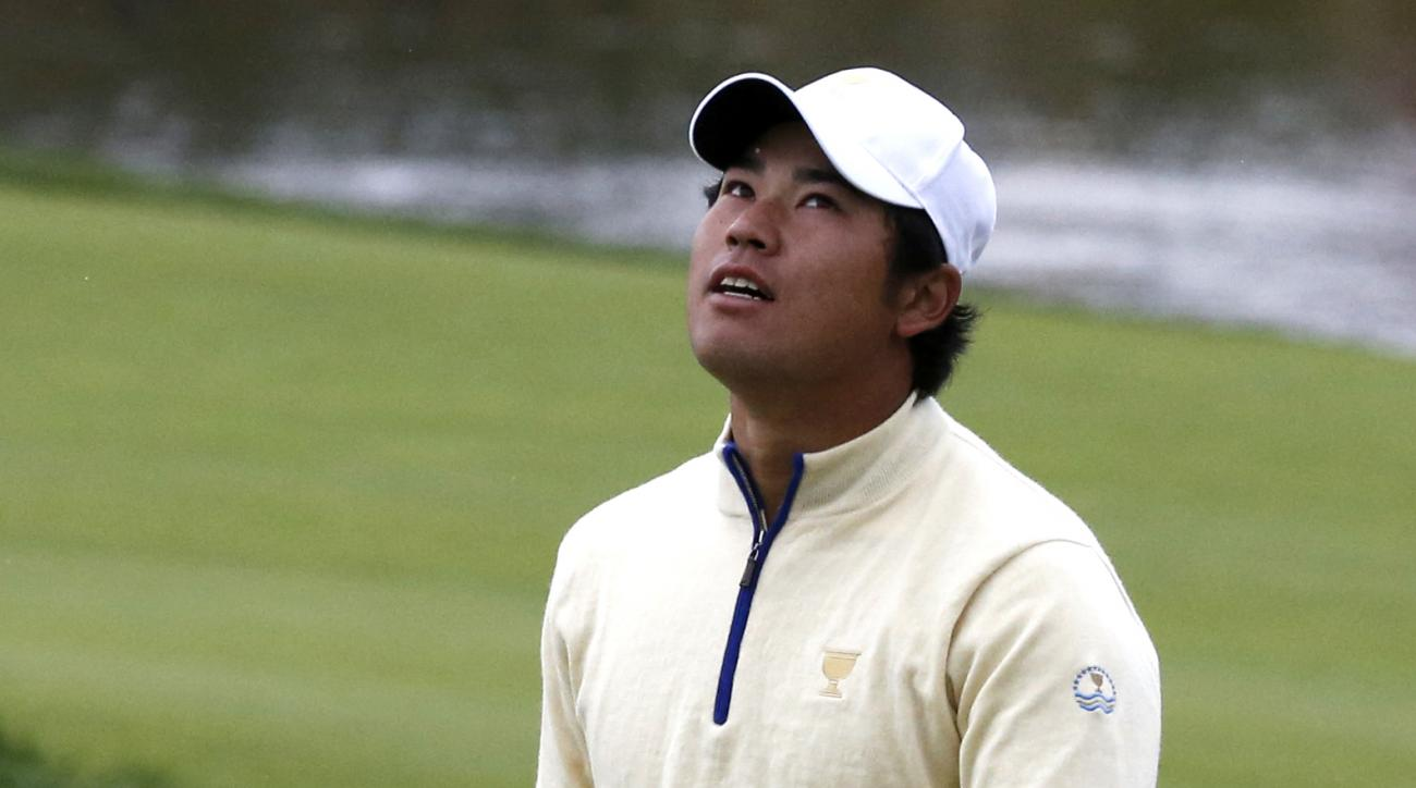 International team player Hedeki Matsuyama of Japan reacts after missing a putt on the 13th green during his singles match against United States' J.B. Holmes at the Presidents Cup golf tournament at the Jack Nicklaus Golf Club Korea, in Incheon, South Kor