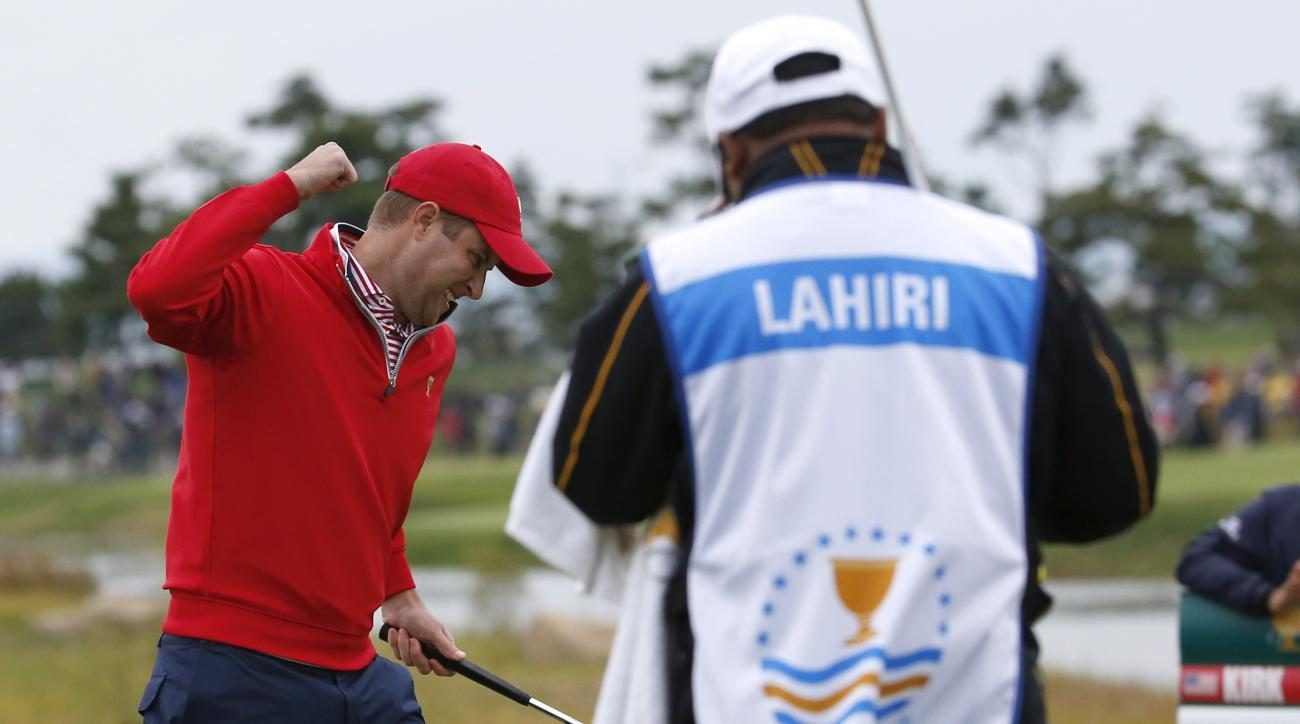 United States' Chris Kirk, left, celebrates after sinking a putt on the 18th green to defeat International team player Anirban Lahiri of India 1up in their singles match at the Presidents Cup golf tournament at the Jack Nicklaus Golf Club Korea, in Incheo