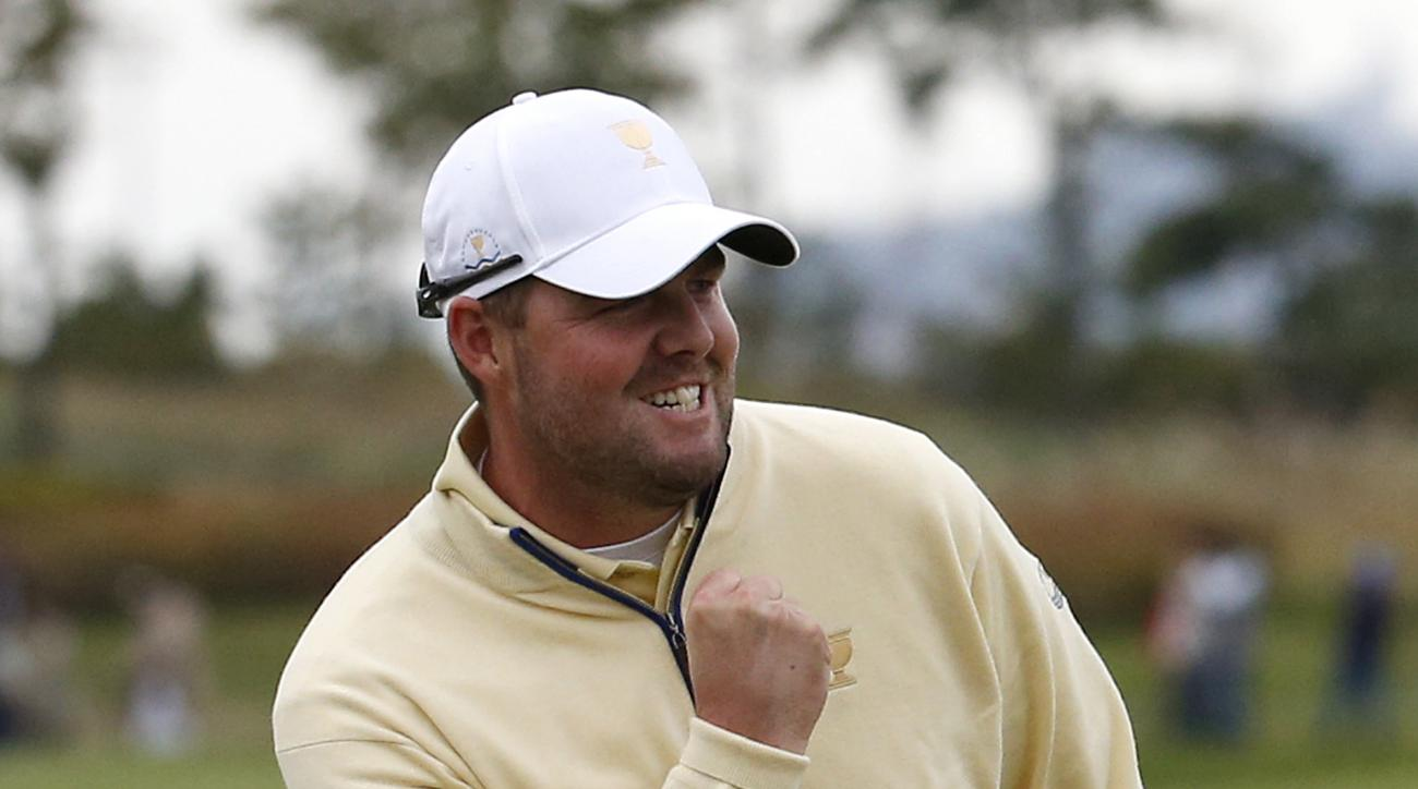 International team player Marc Leishman of Australia reacts after sinking a putt on the 18th green to defeat United States' Jordan Spieth 1up in their singles match at the Presidents Cup golf tournament at the Jack Nicklaus Golf Club Korea, in Incheon, So