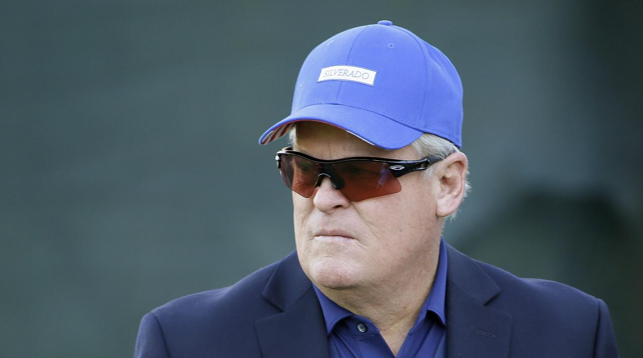 FILE - In this Oct. 12, 2014, file photo, broadcaster and Hall of Fame golfer Johnny Miller stands on the 18th green of the Silverado Resort North Course during the final round of the Frys.com PGA Tour golf tournament in Napa, Calif.  can't wait to get ba