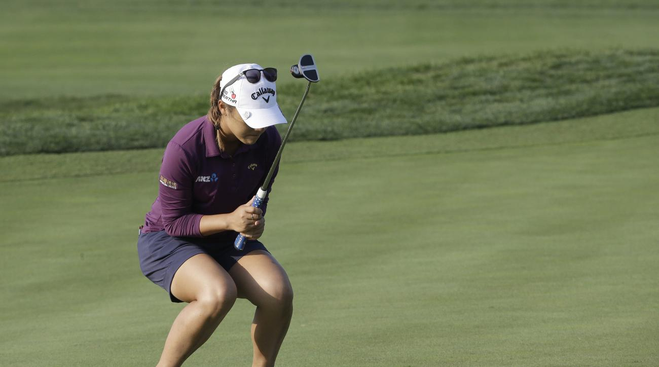 Lydia Ko of New Zealand reacts after sinking a birdie putt on the 18th green during the second round of the KEB Hana Bank Championship golf tournament at Sky72 Golf Club in Incheon, South Korea, Friday, Oct. 16, 2015. (AP Photo/Ahn Young-joon)