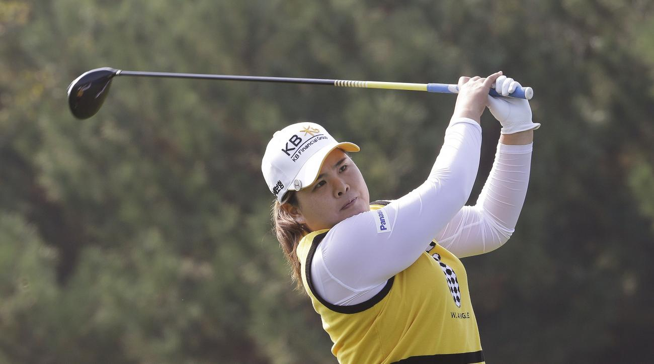 Inbee Park of South Korea watches her shot on the second hole during the second round of the KEB Hana Bank Championship golf tournament at Sky72 Golf Club in Incheon, South Korea, Friday, Oct. 16, 2015. (AP Photo/Ahn Young-joon)