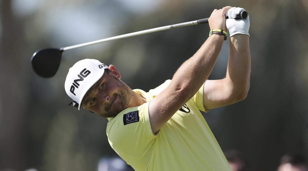 Andy Sullivan of England tees off on the 1st hole during round three of the Dubai Desert Classic golf tournament in Dubai, United Arab Emirates, Saturday, Jan. 31, 2015. (AP Photo/Kamran Jebreili)