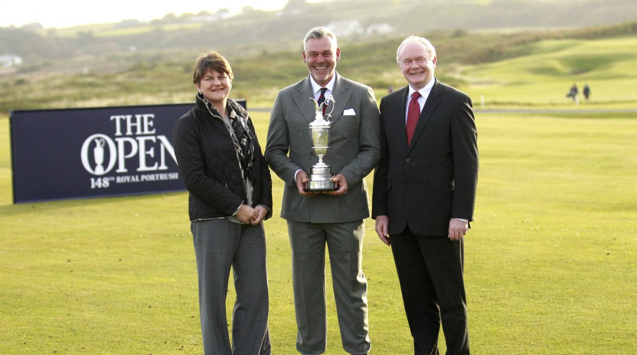 Northern Ireland golfer and former Open golf winner Darren Clarke, centre, with Northern Ireland Deputy First minister Martin McGuinness, right, and Acting First Minister Arlene Foster, left, during a photocall at Royal Portrush, Northern Ireland, Tuesday