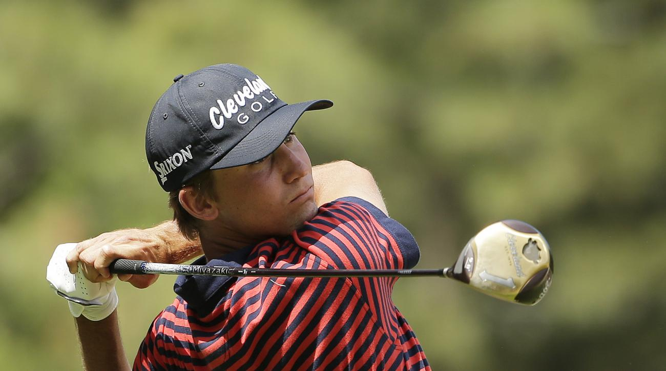Smylie Kaufman watches his tee shot on the second hole during the first round of the U.S. Open golf tournament in Pinehurst, N.C., Thursday, June 12, 2014. (AP Photo/Chuck Burton)