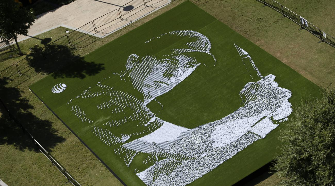 An image of Jordan Spieth is created with golf balls in downtown Dallas, Wednesday, Oct. 28, 2015. Dallas-based AT&T found a unique way to celebrate its corporate relationship with Dallas-based Jordan Spieth. It has installed a mosaic of Spieth's likeness