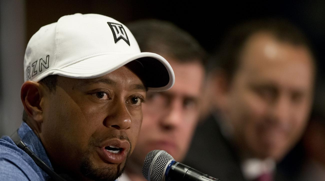 Tiger Woods responds to a question during a press conference to launch the Bridgestone America's Golf Cup in Mexico City, Tuesday, Oct. 20, 2015. Woods withdrew from the Bridgestone America's Golf Cup and two other events he had planned to play this year