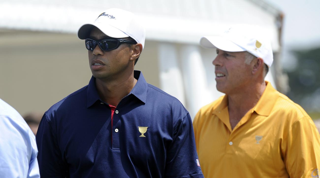 FILE - In this Thursday, Nov. 17, 2011 file photo, Tiger Woods, left, of the U.S. team and his former caddie Steve Williams stand on the first tee during the first round of the Presidents Cup golf tournament at Royal Melbourne Golf Course, in Melbourne, A