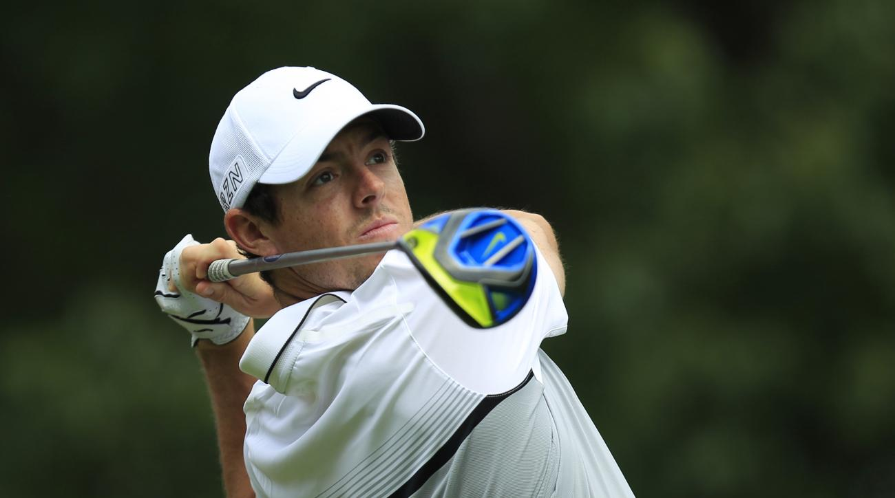 Rory McIlroy of Northern Ireland tees off on the 14th hole during the first round of the HSBC Champions golf tournament at the Sheshan International Golf Club in Shanghai, China Thursday, Nov. 5, 2015. (AP Photo)