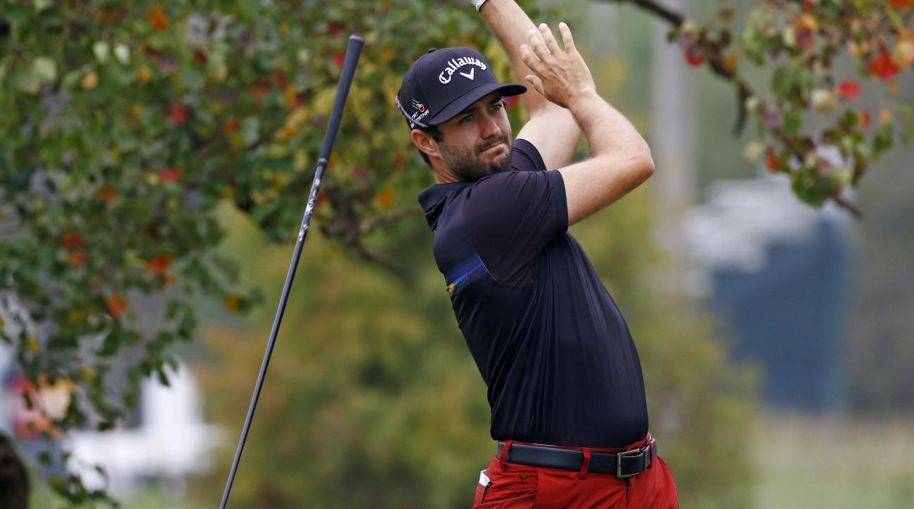 Adam Hadwin of Canada drops his club after his drive on the sixth tee during the first round of the Sanderson Farms Classic golf tournament at the Country Club of Jackson, Thursday, Nov 5, 2015,  in Jackson, Miss. (AP Photo/Rogelio V. Solis)