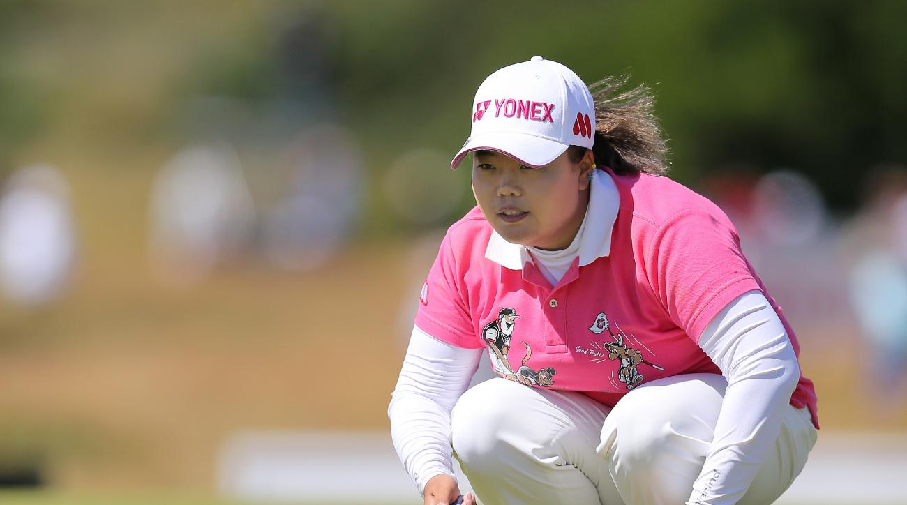 South Korea's Sun Ju Ahn lines up a putt on the 9th green during the final day of the women's British Open golf championship at the Royal Birkdale Golf Club, in Southport, England, Sunday, July 13, 2014. (AP Photo/Scott Heppell)