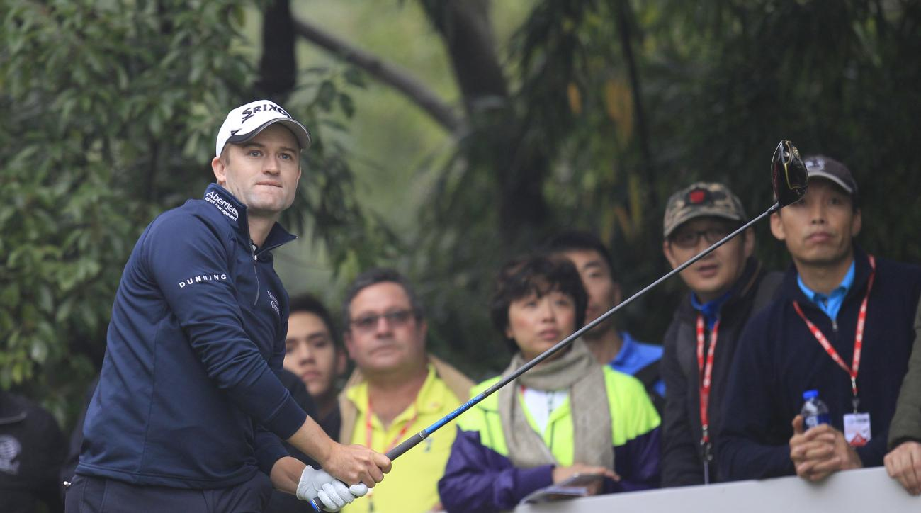 Russell Knox of Scotland looks at his shot on the 7th hole during the final round of the HSBC Champions golf tournament at the Sheshan International Golf Club in Shanghai, China Sunday, Nov. 8, 2015. (AP Photo)