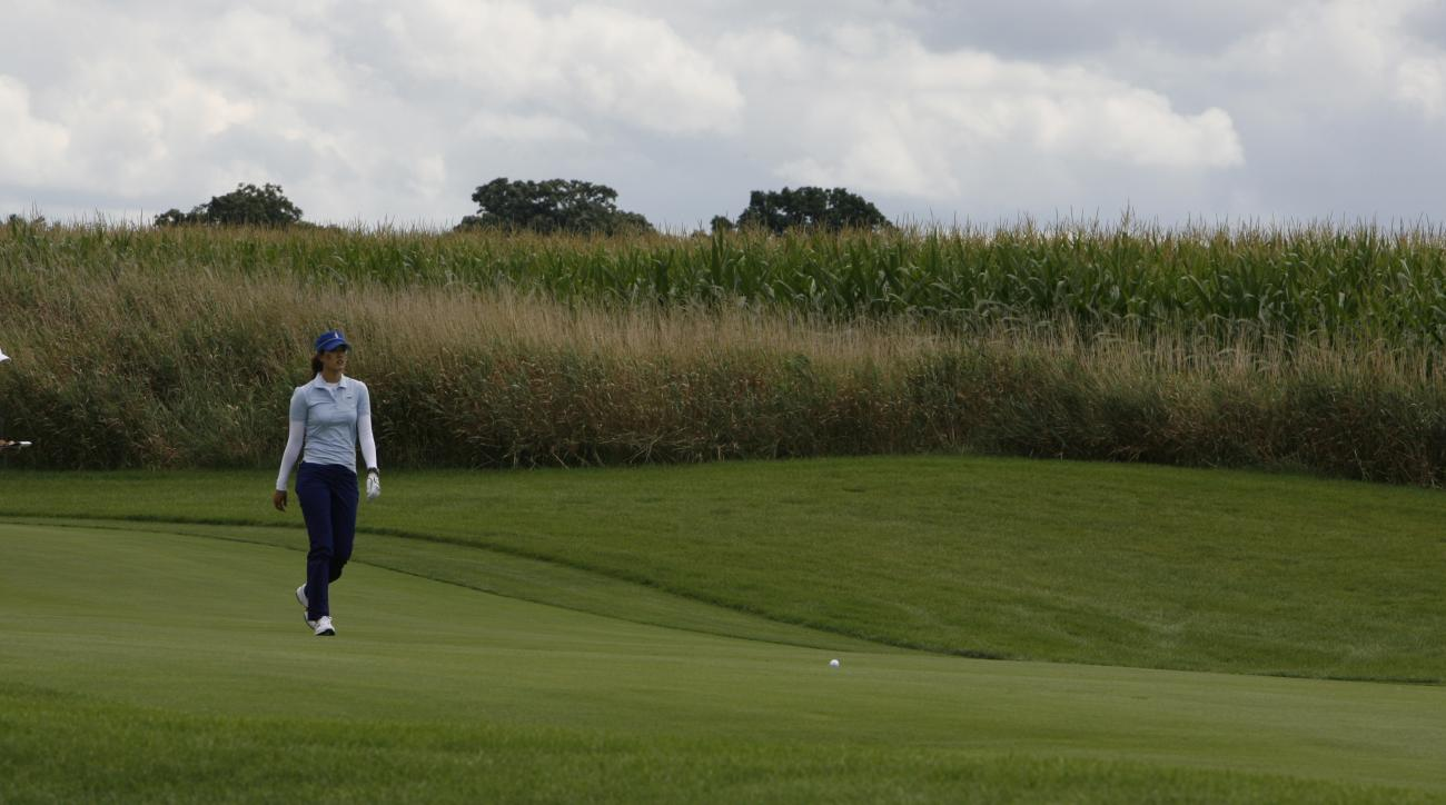 Team USA's Michelle Wie during a four-ball match at the Solheim Cup golf tournament Friday, Aug. 21, 2009, at Rich Harvest Farms in Sugar Grove, Ill. (AP Photo/Nam Y. Huh)