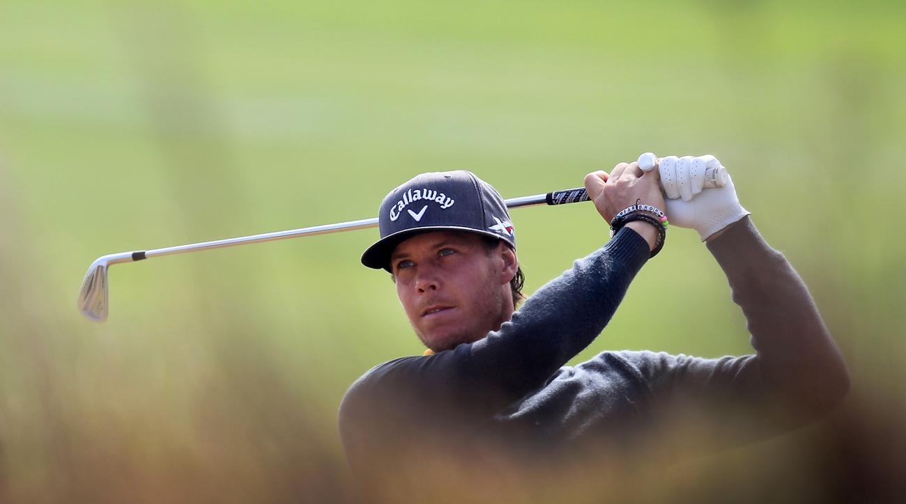 Kristoffer Broberg of Sweden watches his shot on the 5th hole during the third round of the BMW Masters golf tournament at the Lake Malaren Golf Club in Shanghai, China, Saturday, Nov. 14, 2015. (AP Photo)