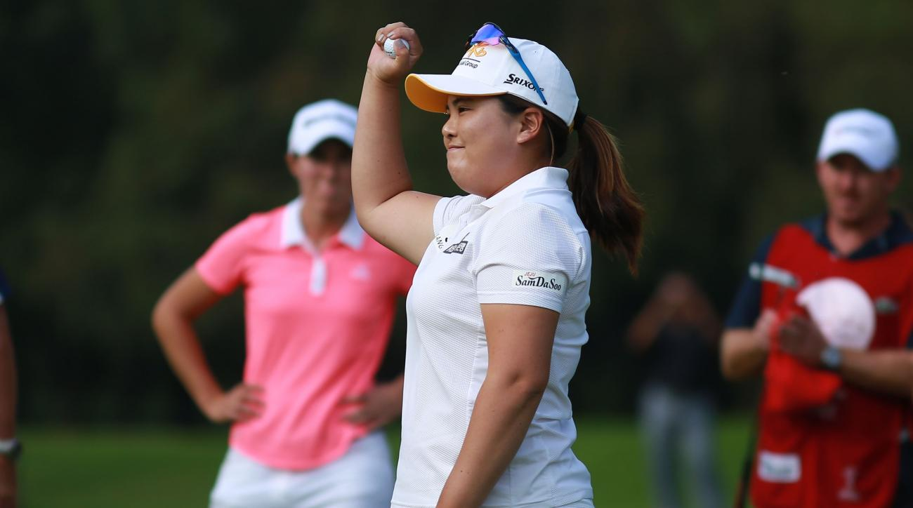 South Korea's Inbee Park celebrates after winning the LPGA Lorena Ochoa Invitational in Mexico City, Sunday, Nov. 15, 2015. Inbee Park won the Invitational, holding off Carlota Ciganda for her fifth victory of the season and 17th LPGA Tour title. (AP Phot