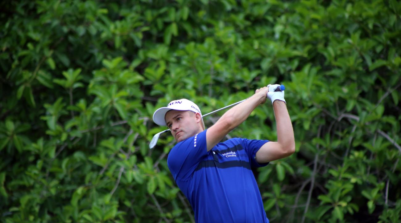 Russell Knox, from  Jacksonville Beach Fl.  plays the the 10th hole before the final round was stopped Sunday, Nov. 15, 2015 in the rain-delayed OHL Classic at Mayakoba near Playa del Carmen, Mexico setting up a sprint to the finish Monday. The fourth rou