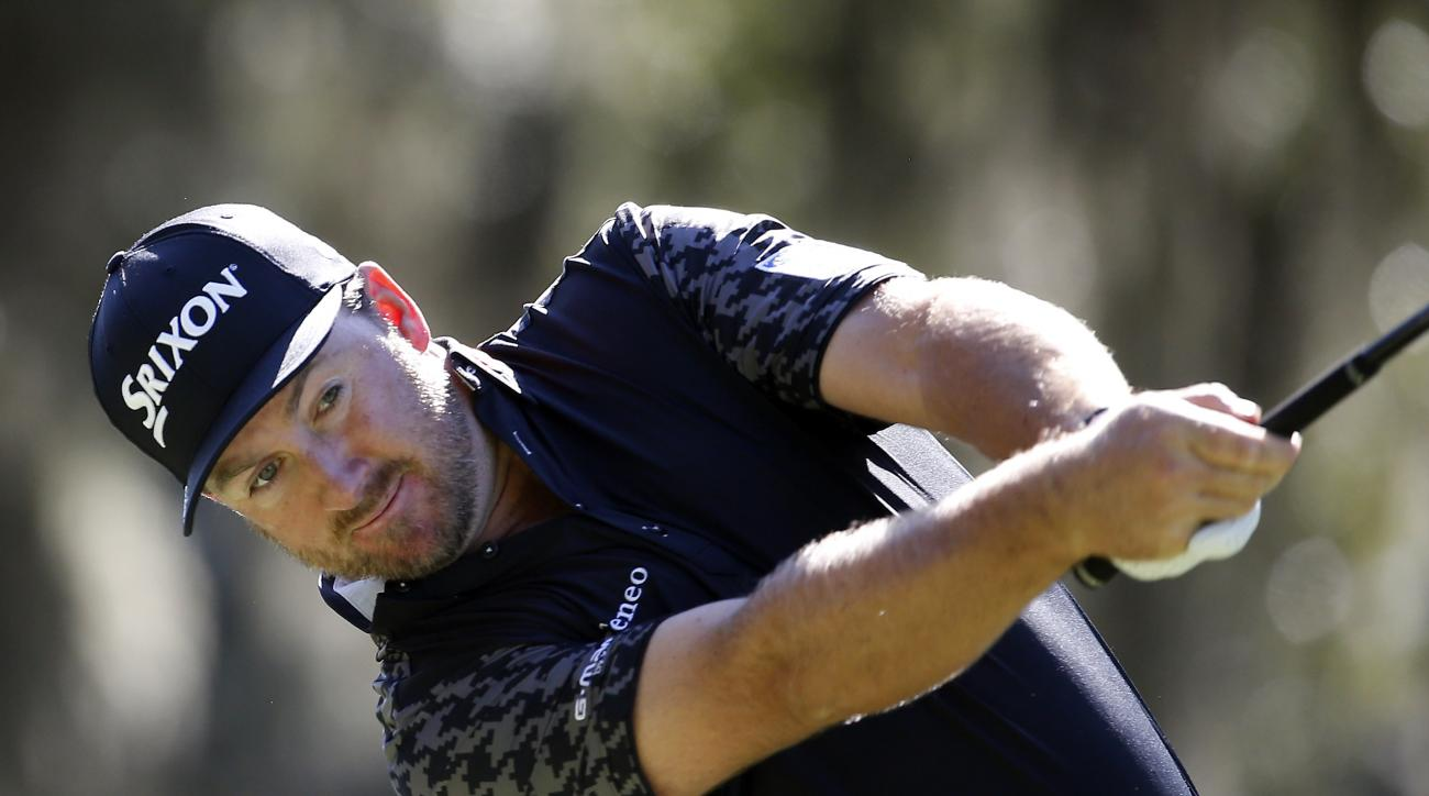 Graeme McDowell, of Northern Ireland, watches his tee shot down the fifth fairway on the Plantation Course at the Sea Island Golf Club during the second round at the RSM Classic golf tournament, Friday, Nov 20, 2015, in St. Simons Island, Ga. (AP Photo/St