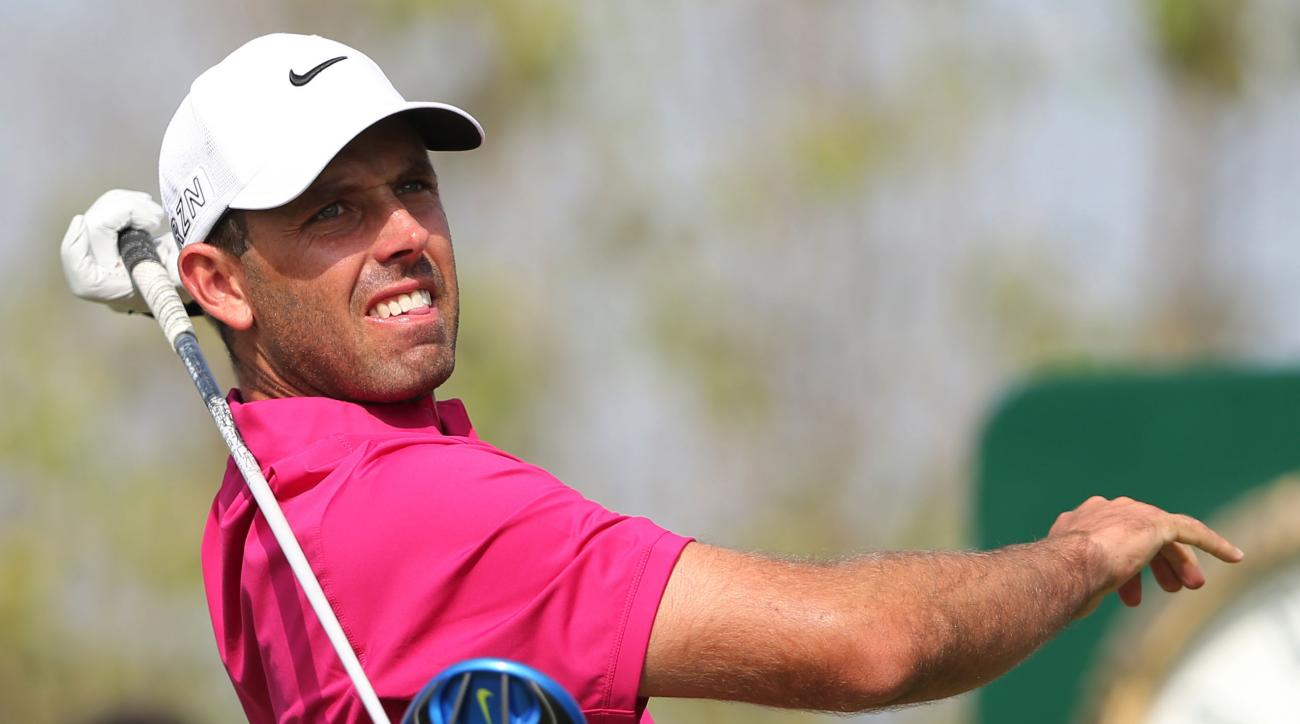 Charl Schwartzel of South Africa tees off on the 2nd hole during the third round of DP World Tour Championship golf tournament in Dubai, United Arab Emirates, Saturday, Nov. 21, 2015. (AP Photo/Kamran Jebreili)