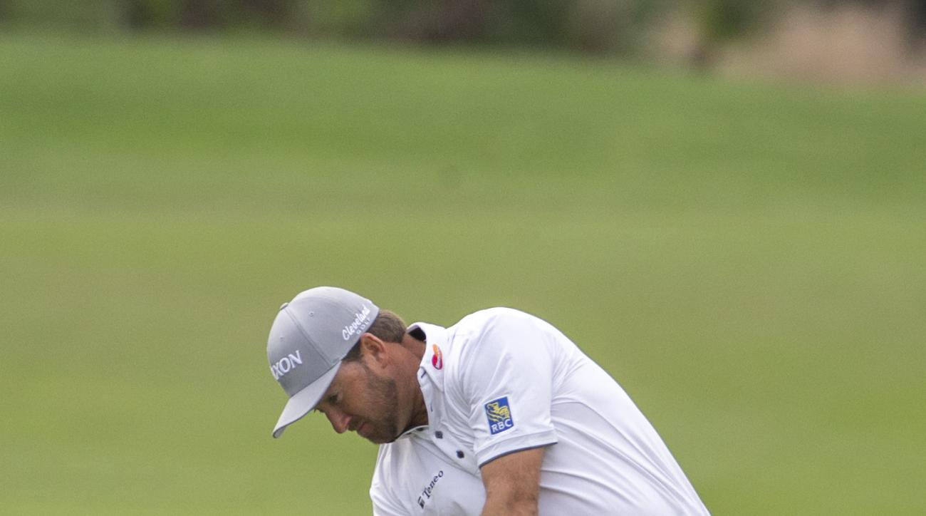 Graeme McDowell, of Northern Ireland, hits from the first fairway on the Seaside Course at the Sea Island Golf Club during the third round at the RSM Classic golf tournament, Saturday, Nov. 21, 2015, in St. Simons Island, Ga. (AP Photo/Stephen B. Morton)