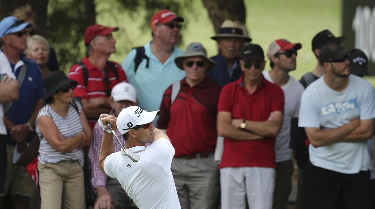 Adam Scott of Australia plays a fairway shot on the 7th hole during the Australia Open Golf Tournament in Sydney, Australia, Friday, Nov. 27, 2015. (AP Photo/Rob Griffith)