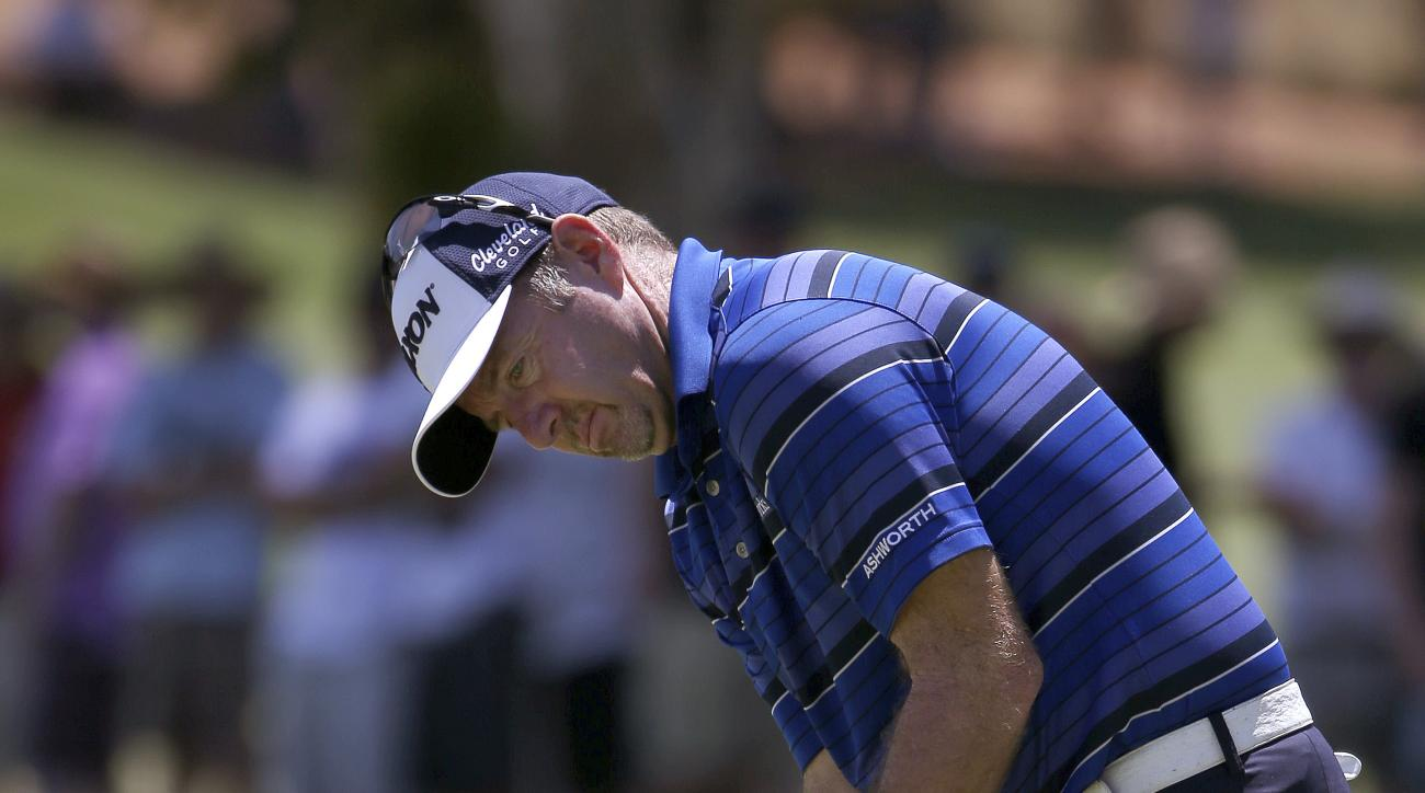 Australia's Rod Pampling putts on the 4th green during the third round of the Australian Open Golf championship in Sydney, Saturday, Nov. 29, 2014. (AP Photo/Rick Rycroft)