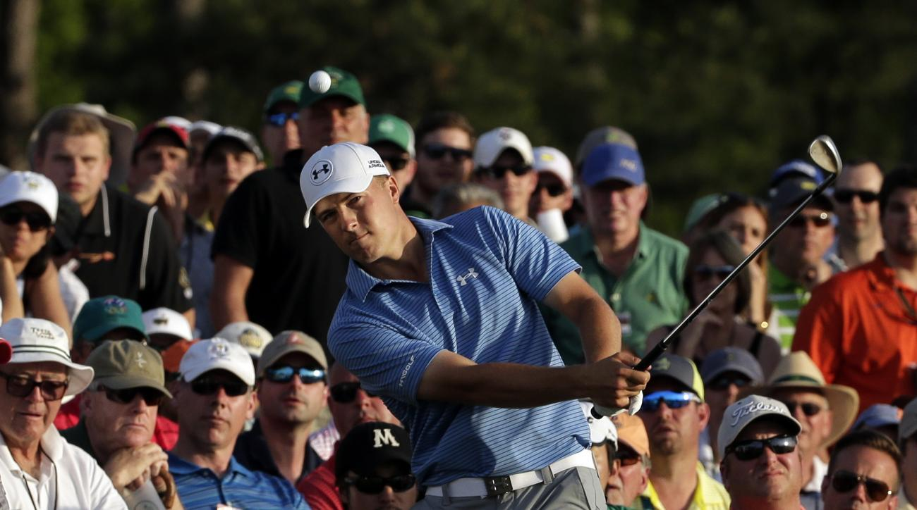 FILE - In this April 11, 2015, file photo, Jordan Spieth hits out of the gallery on the 18th hole during the third round of the Masters golf tournament, in Augusta, Ga. He hit a flop shot with his 60-degree wedge, a high-risk shot that brought a big rewar