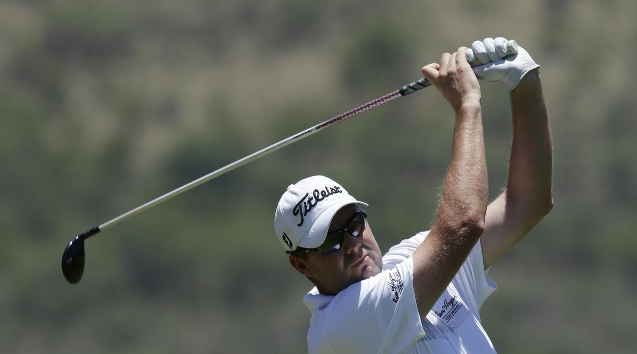 Marc Leishman of Australian, plays a shot on the 2nd fairway during the final round of the Golf Challenge at the Gary Player Country Club in Sun City, South Africa, Sunday, Dec. 6, 2015.  (AP Photo/Themba Hadebe)
