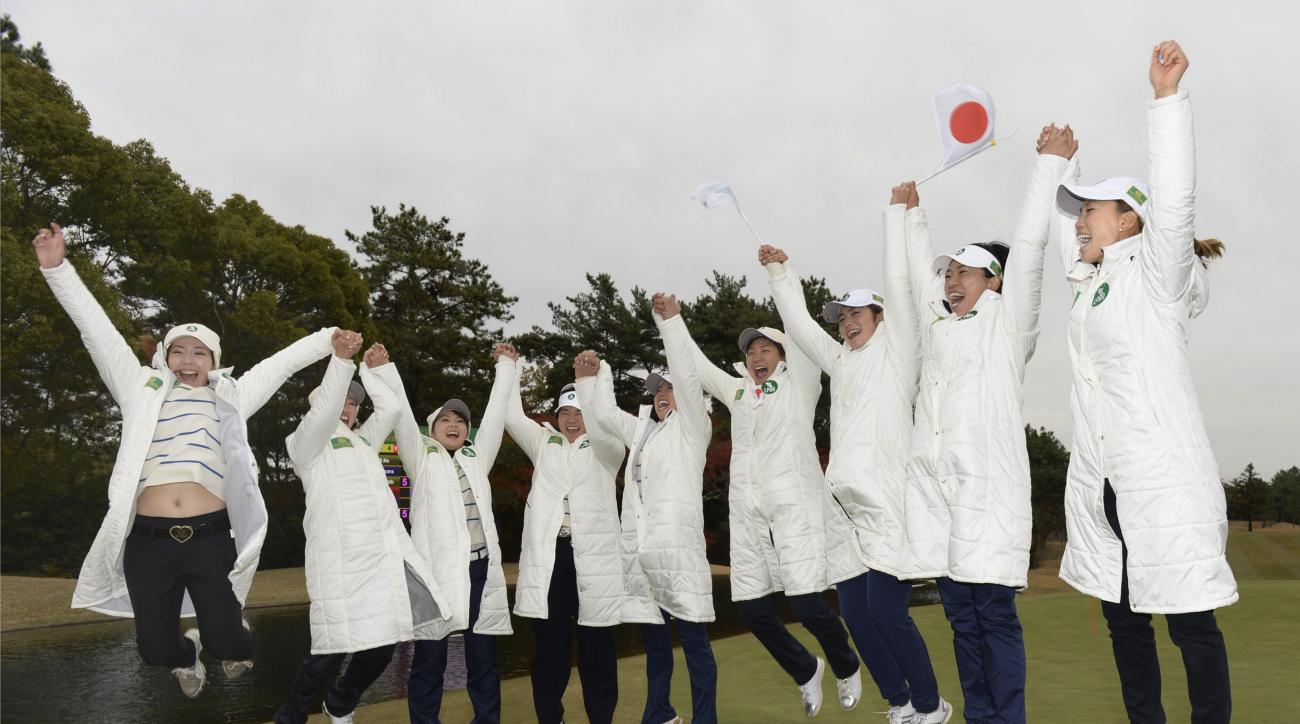 Japan LPGA team members led by its captain Momoko Ueda, right, jump hands in hands in celebration after capturing the inaugural Queens match-play tournament between teams from different women's golf tours, in Nagoya, central Japan, Sunday, Dec. 6, 2015. T