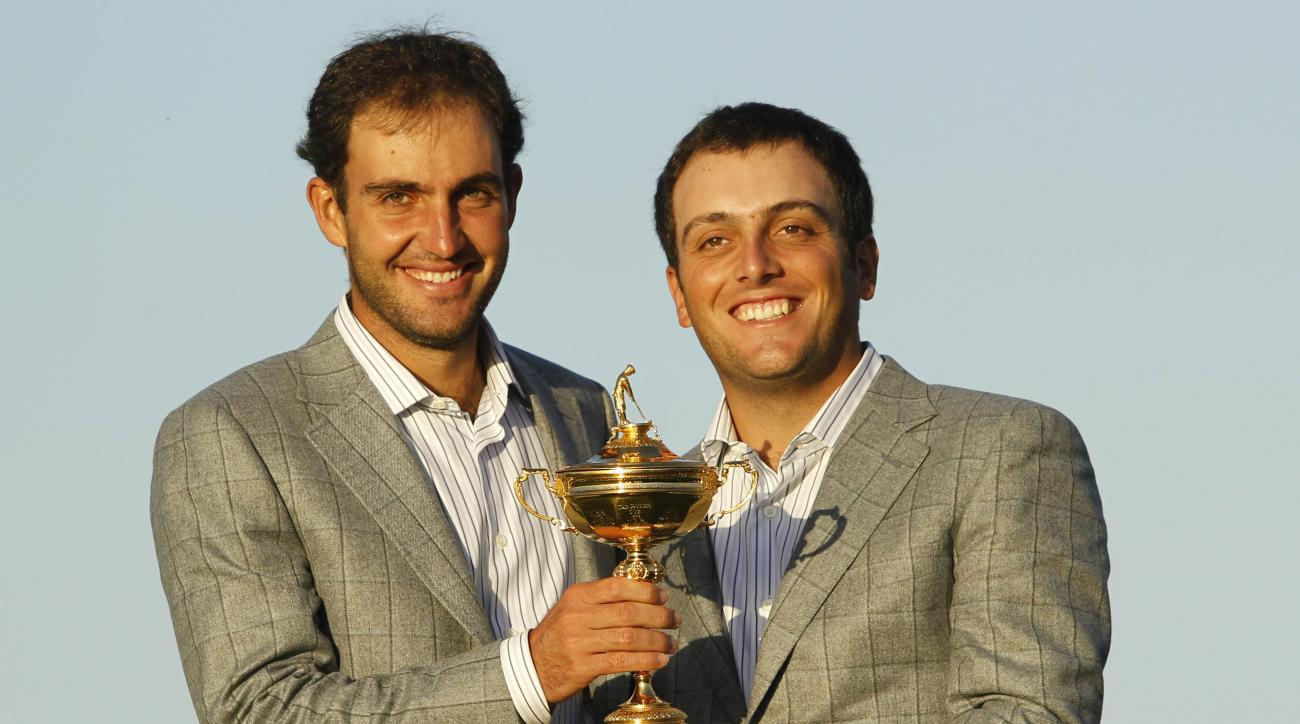 FILE - This is a Monday, Oct.  4, 2010 file photo of Europe's Edoardo Molinari, left, and Francesco Molinari, brothers from Italy, as they hold the trophy after Europe won the 2010 Ryder Cup golf tournament at the Celtic Manor Resort in Newport, Wales. Th