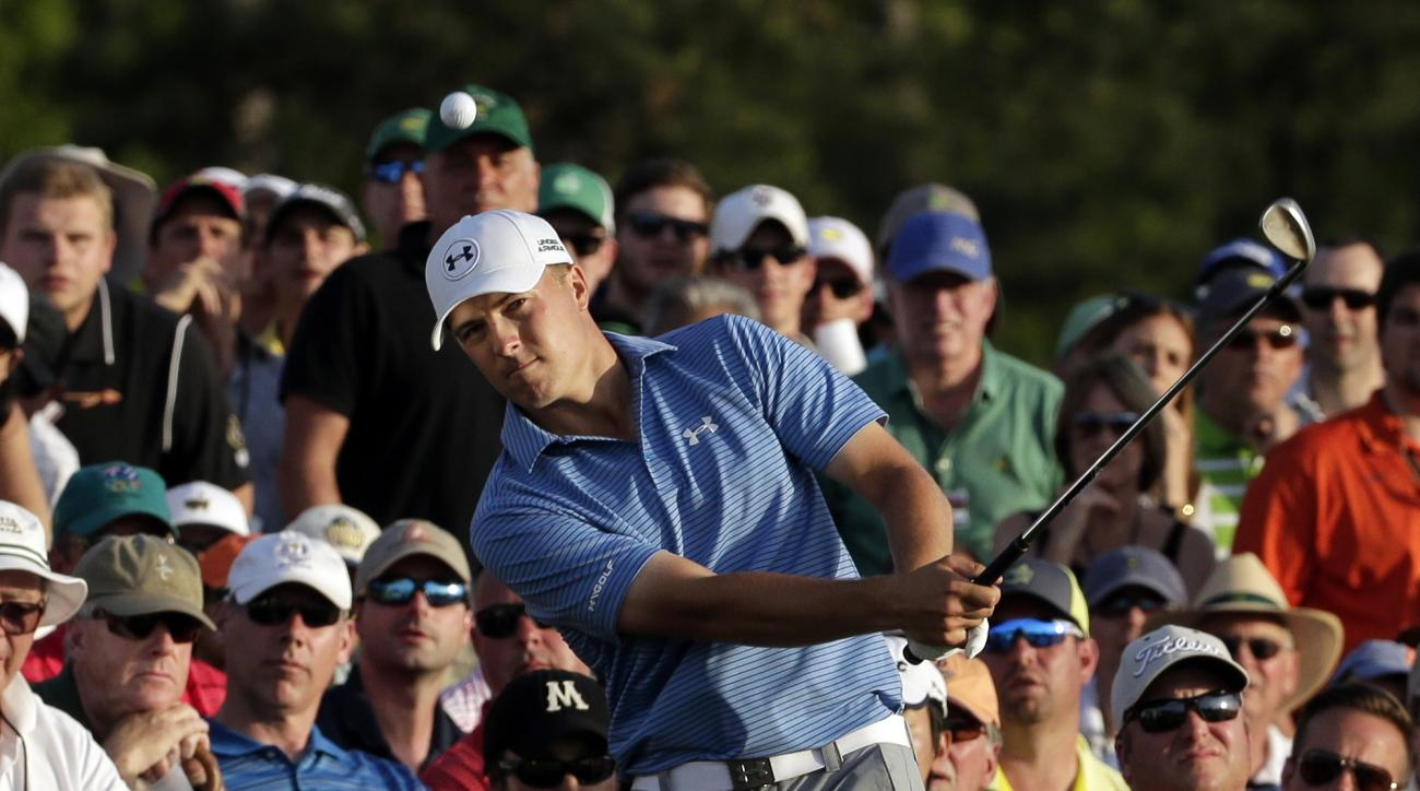 FILE - In this April 11, 2015, file photo, Jordan Spieth chips from the gallery on the 18th hole during the third round of the Masters golf tournament in Augusta, Ga. In a wire-to-wire win, the biggest moment for Spieth was on the 18th hole in the third r