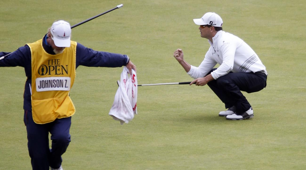 FILE - In this July 20, 2015, file photo United States' Zach Johnson celebrates a birdie putt on the 18th green during the final round at the British Open Golf Championship at the Old Course, St. Andrews, Scotland. Major championships produce shots that c