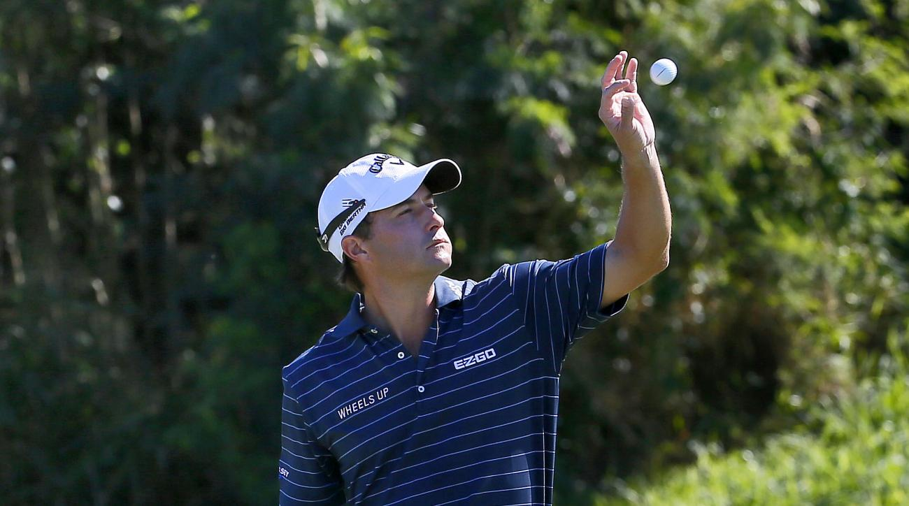 Kevin Kisner catches the ball tossed by his caddie on the sixth green during the first round of the Tournament of Champions golf event Thursday, Jan. 7, 2016, at Kapalua Plantation Course in Kapalua, Hawaii. (AP Photo/Matt York)