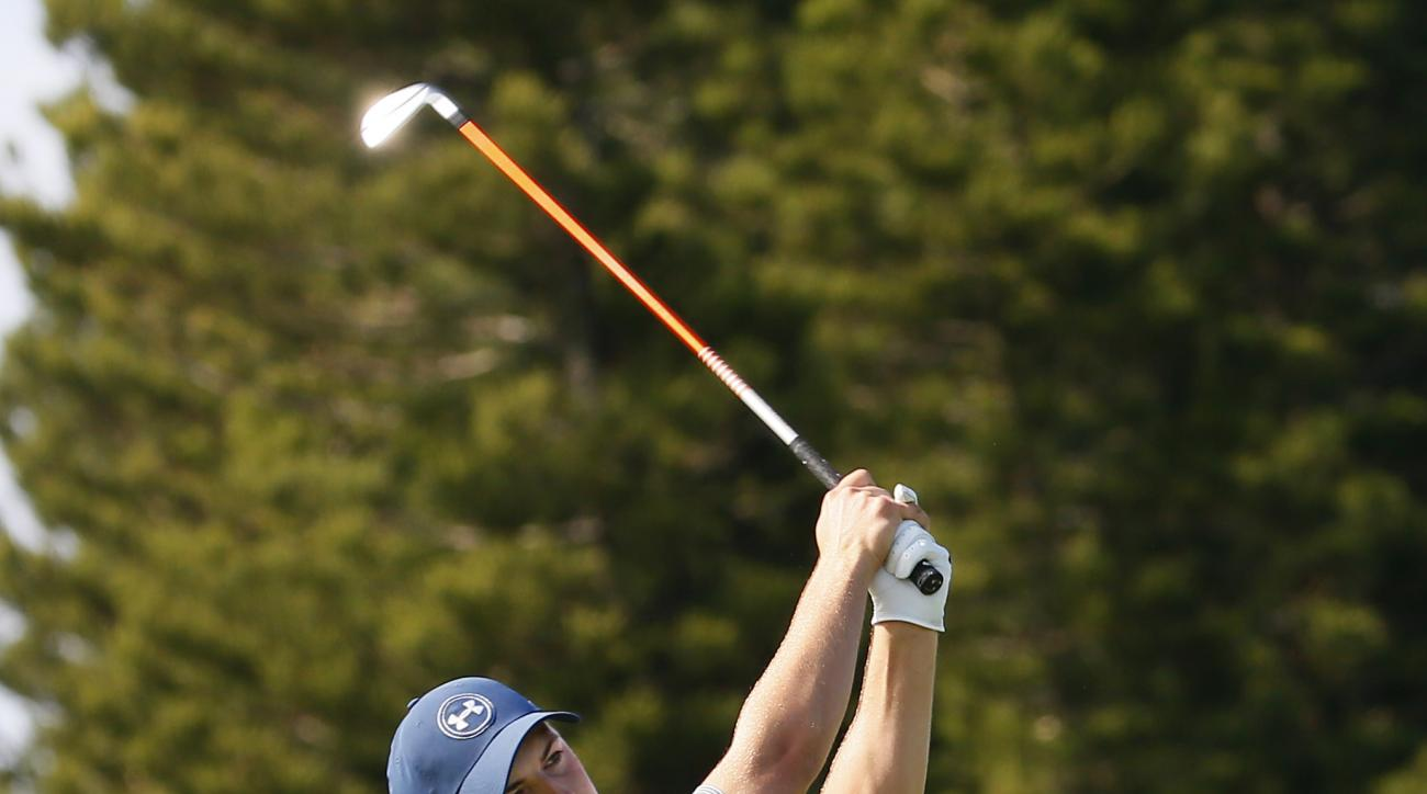 Jordan Spieth hits from the ninth fairway during the second round of the Tournament of Champions golf tournament Friday, Jan. 8, 2016, at Kapalua Plantation Course on Kapalua, Hawaii. (AP Photo/Matt York)