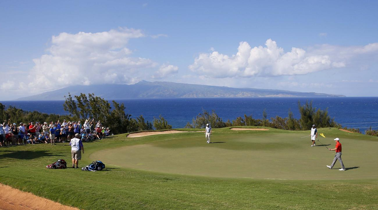 Jordan Spieth, right, reacts after making his birdie putt on the 12th green during the third round of the Tournament of Champions golf tournament, Saturday, Jan. 9, 2016, at Kapalua Plantation Course on Kapalua, Hawaii. (AP Photo/Matt York)