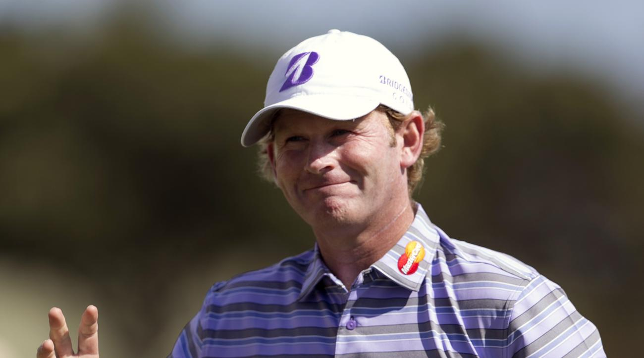 Brandt Snedeker waves to the gallery after his birdie putt on the third green during the third round of the Sony Open golf tournament, Saturday, Jan. 16, 2016, in Honolulu. (AP Photo/Marco Garcia)