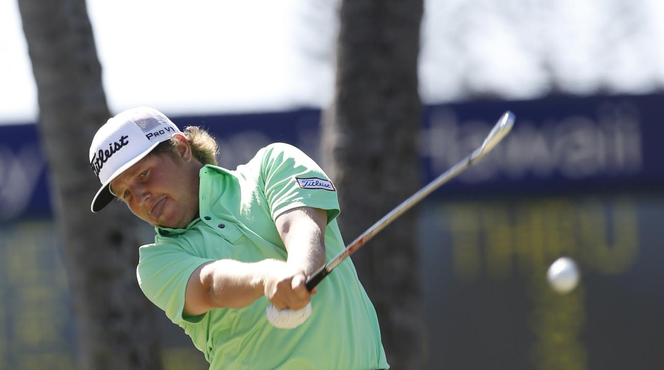 Zac Blair drives off the fourth tee during the final round of the Sony Open golf tournament, Sunday, Jan. 17, 2016, in Honolulu. (AP Photo/Marco Garcia)