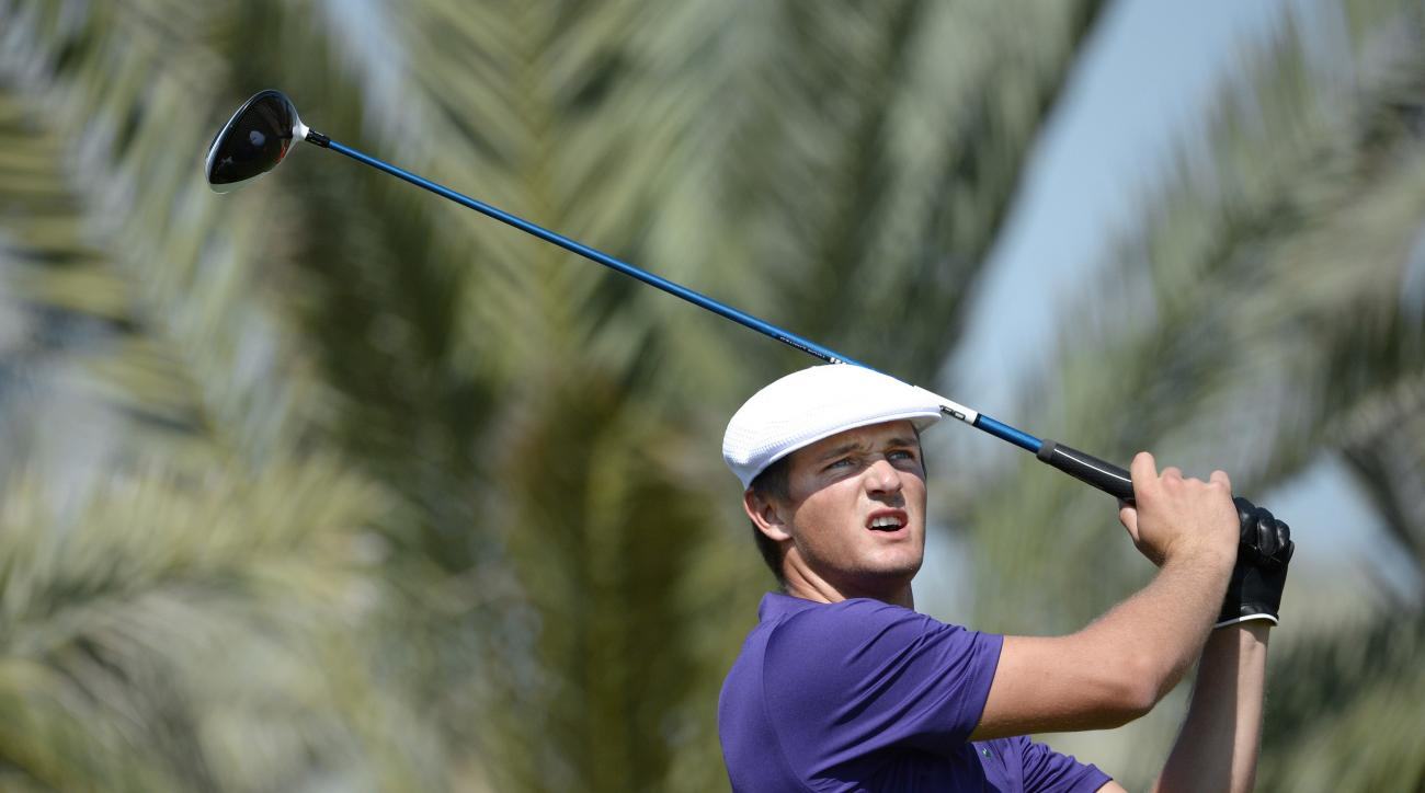 Bryson Dechambeau of the Unites States tees off at the 14th hole during the round one of Abu Dhabi HSBC Golf Championship in Abu Dhabi, United Arab Emirates, Thursday, Jan. 21, 2016. (AP Photo/Martin Dokoupil)