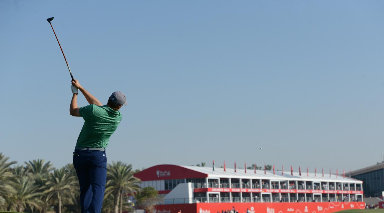 Jordan Spieth of the United States strikes the ball at the 18th fairway during the round one of Abu Dhabi HSBC Golf Championship in Abu Dhabi, United Arab Emirates, Thursday, Jan. 21, 2016. (AP Photo/Martin Dokoupil)