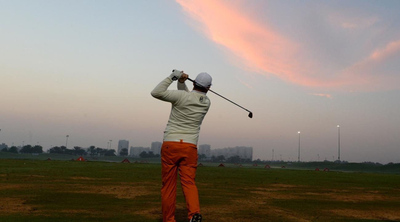 Andy Sullivan of England strikes the ball on the practice range before fog delayed the start of the second round of the Abu Dhabi HSBC Golf Championship in Abu Dhabi, United Arab Emirates, Friday, Jan. 22, 2016. (AP Photo/Martin Dokoupil)