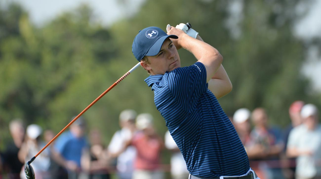 Jordan Spieth of the United States, the world number  one, strikes the ball at the 18th fairway during the round two of the fog-delayed Abu Dhabi Golf Championship in Abu Dhabi, United Arab Emirates, Saturday, Jan. 23, 2016. (AP Photo/Martin Dokoupil)