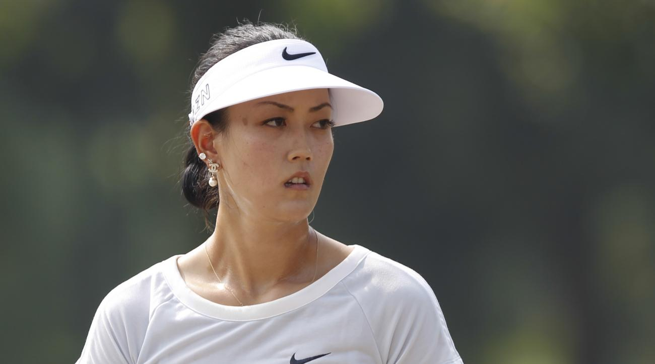 """FILE - This Oct. 7, 2015 file photo shows Michelle Wie, of the United States, during the first round of the LPGA Malaysia golf tournament at Kuala Lumpur Golf and Country Club in Kuala Lumpur, Malaysia. Wie described her offseason as """"doing nothing."""" Exce"""