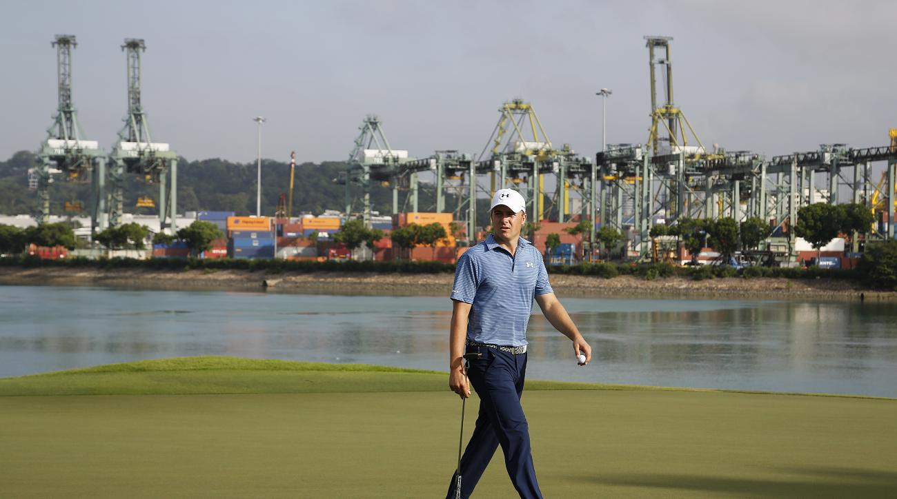 Jordan Spieth of the United States walks on the 15th hole during the first round of the SMBC Singapore Open golf tournament at the Sentosa Golf Club's Serapong Course on Thursday, Jan. 28, 2016, in Singapore. Seen in the background is the port of Singapor