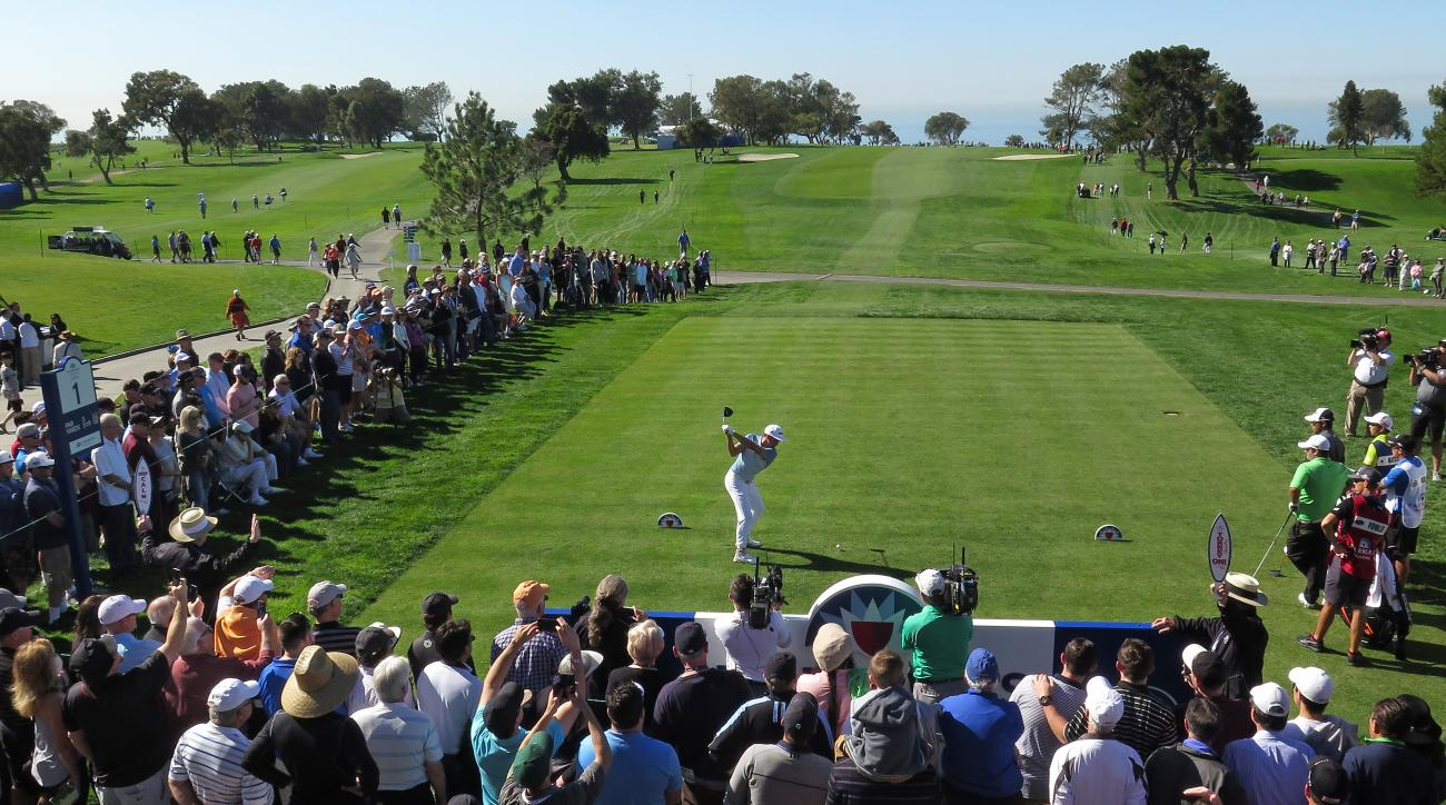 Rickie Fowler, center, tees off on the first hole in the Farmers Insurance Open golf tournament Thursday, Jan. 28, 2016, in San Diego, Calif. (K.C. Alfred/U-T San Diego via AP)  NO SALES; MANDATORY CREDIT