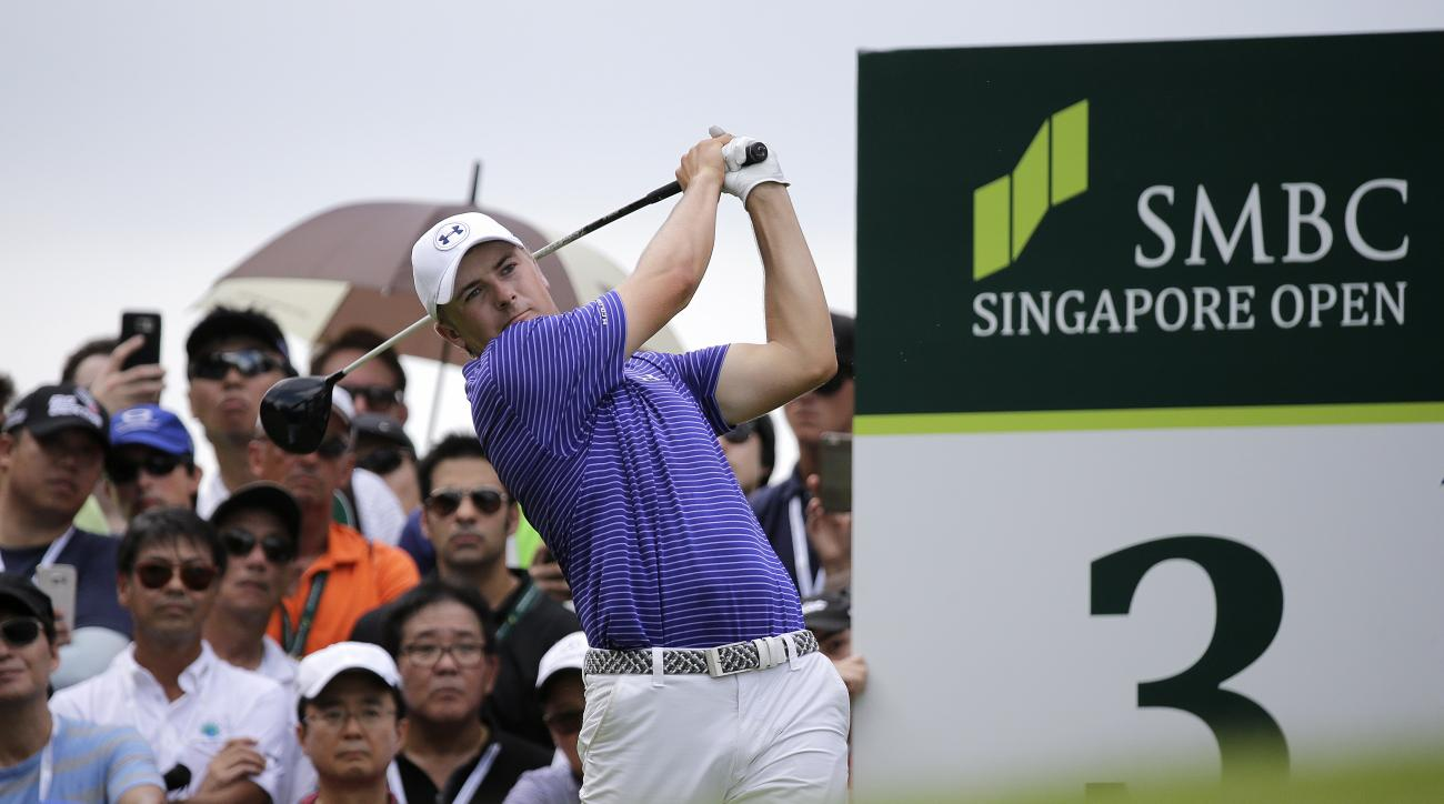 Jordan Spieth of the United States tees off on the third hole during the third round of the SMBC Singapore Open golf tournament at Sentosa Golf Club's Serapong Course on Saturday, Jan. 30, 2016, in Singapore. (AP Photo/Wong Maye-E)